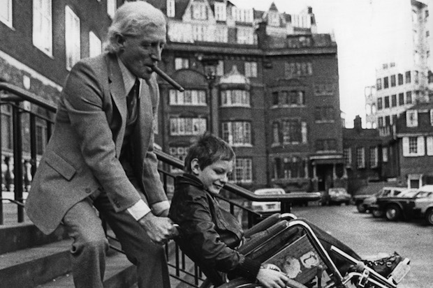 English dj and television presenter Jimmy Savile (1926 - 2011) with 10 year-old Roddy Cameron, a former patient at Stoke Mandeville Hospital, 23rd January 1980. Savile has just launched a ten million-pound appeal for the hospital. (Photo by Graham Morris/Evening Standard/Hulton Archive/Getty Images)